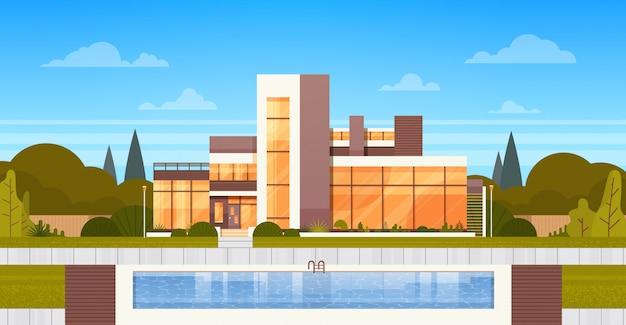 Villa de luxo com piscina exterior da casa moderna Vetor Premium