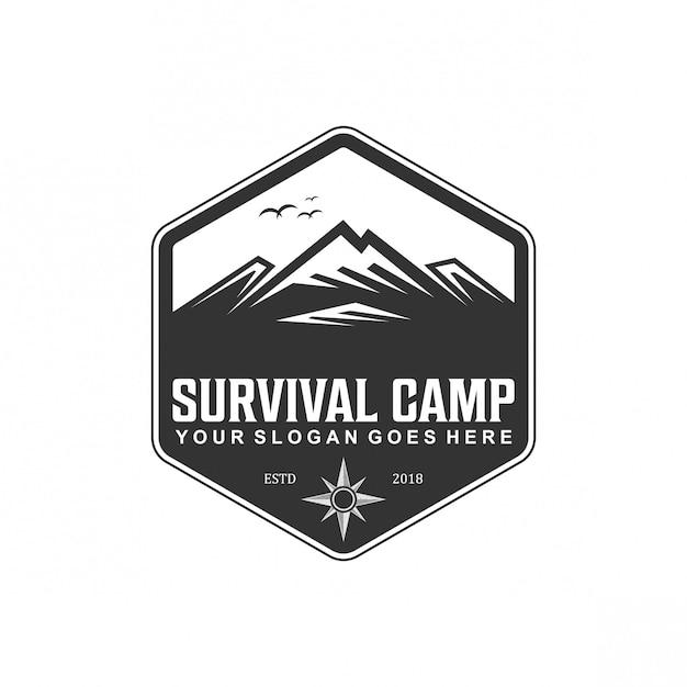 Vintage de logotipo de acampamento de sobrevivência Vetor Premium
