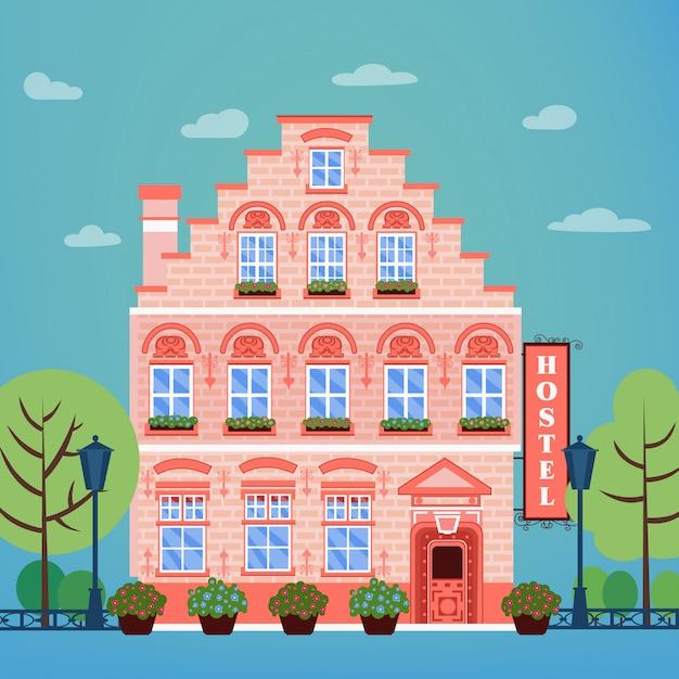 Vintage europeu city hostel. fachada do edifício do hotel da indústria do curso Vetor Premium