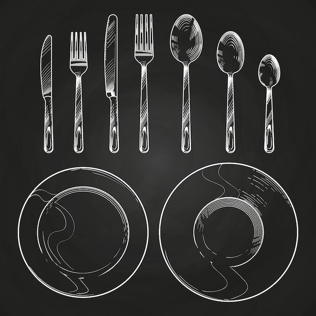Vintage faca, garfo, colher e pratos no estilo de gravura de desenho. mão desenhando talheres no quadro-negro Vetor Premium