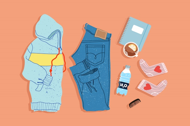 Vista de cima para baixo na moda roupa esporte. estilo de instagram desenhados à mão colocar ilustração. hoodie moderno, jeans, meias e caderno sobre um fundo liso. objetos são. Vetor Premium