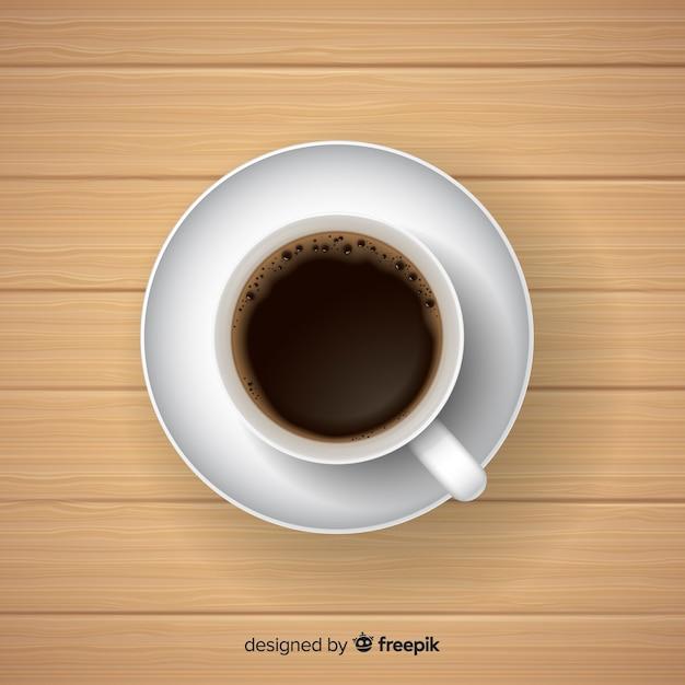 Vista superior da xícara de café com design realista Vetor grátis
