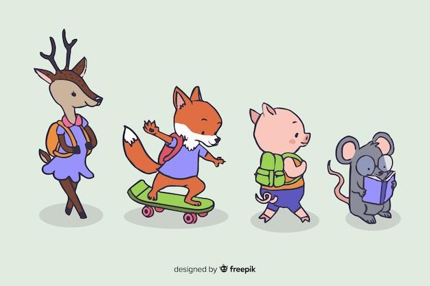 Volta para escola design com animais fofos Vetor grátis