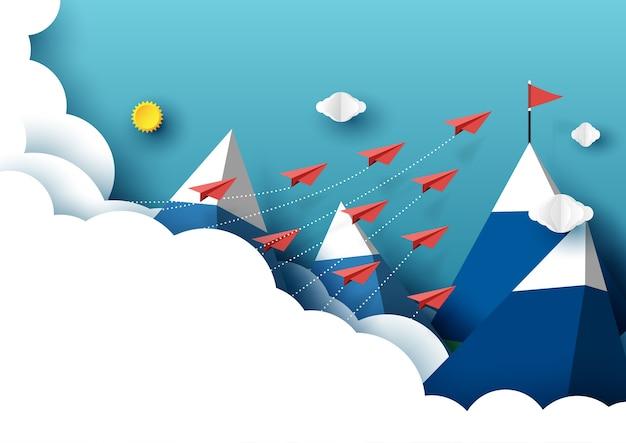 Voo dos trabalhos de equipa dos aviões de papel da nuvem à bandeira vermelha. Vetor Premium