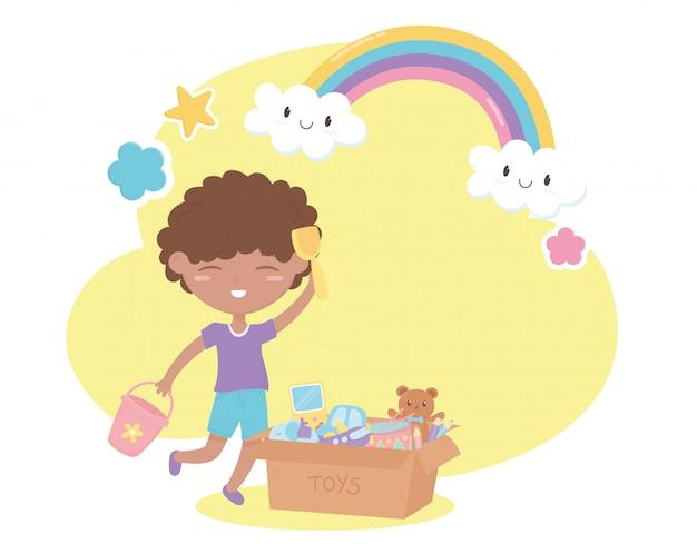 Zona de crianças, menino bonitinho com balde de pá e caixa de brinquedos Vetor Premium