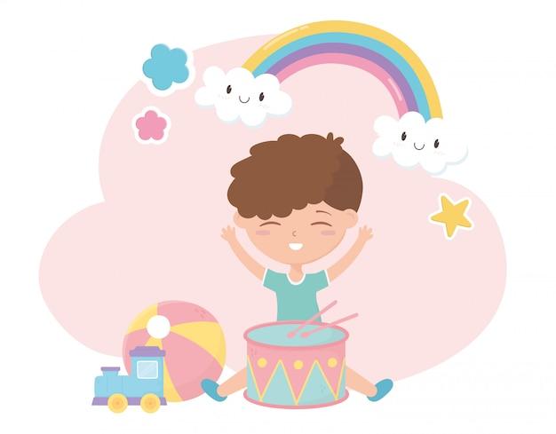 Zona de crianças, menino bonitinho com brinquedos de trem de bola de tambor Vetor Premium