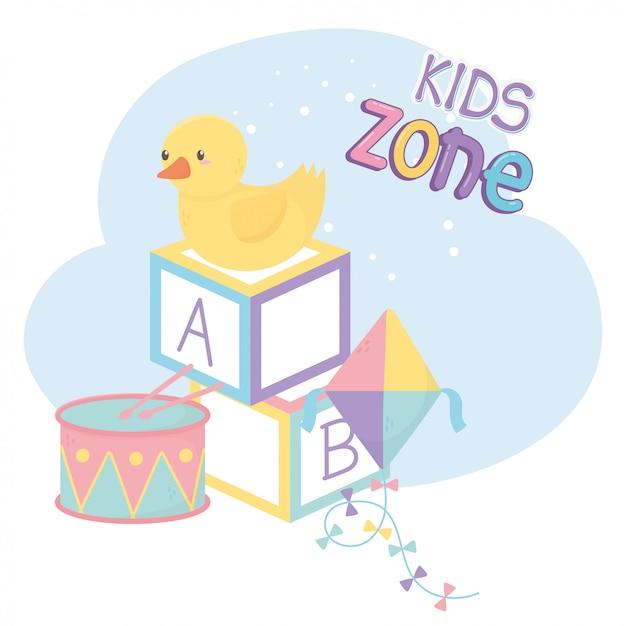 Zona infantil, blocos de alfabeto, pipa de pato e brinquedos de bateria Vetor Premium