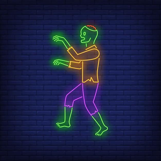 Zumbi andando sinal de néon Vetor grátis