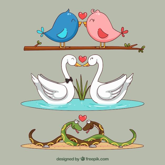 Accumulazione delle coppie animali di san valentino disegnato a mano Vettore gratuito