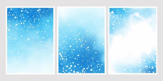 Acquerello blu con la neve che cade sullo sfondo Vettore Premium