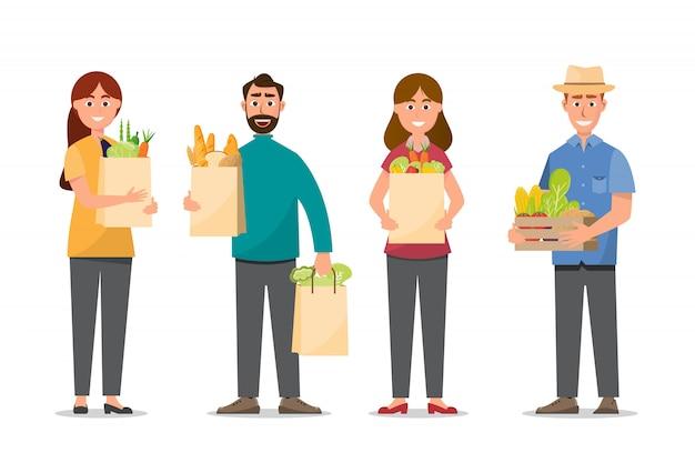 Acquisto della donna e dell'uomo e tenere l'alimento pieno delle borse Vettore Premium