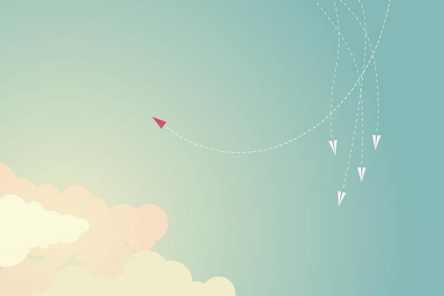 Aeroplano rosso di stile minimalista che cambia direzione e uni. Vettore Premium