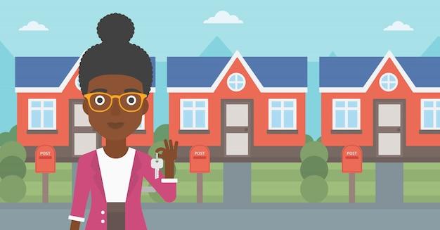 Agente immobiliare con illustrazione vettoriale chiave. Vettore Premium