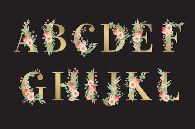 Alfabeto dorato con disegno floreale Vettore gratuito