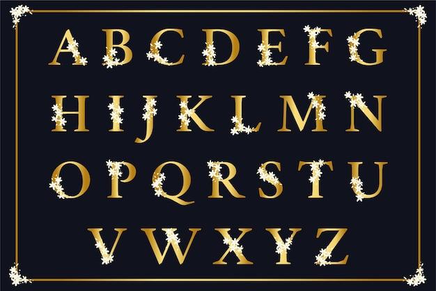 Alfabeto dorato con il concetto di fiori eleganti Vettore gratuito
