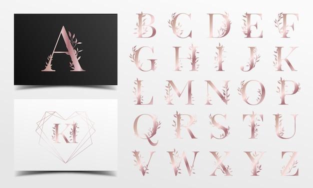 Alfabeto in oro rosa con motivi floreali Vettore Premium