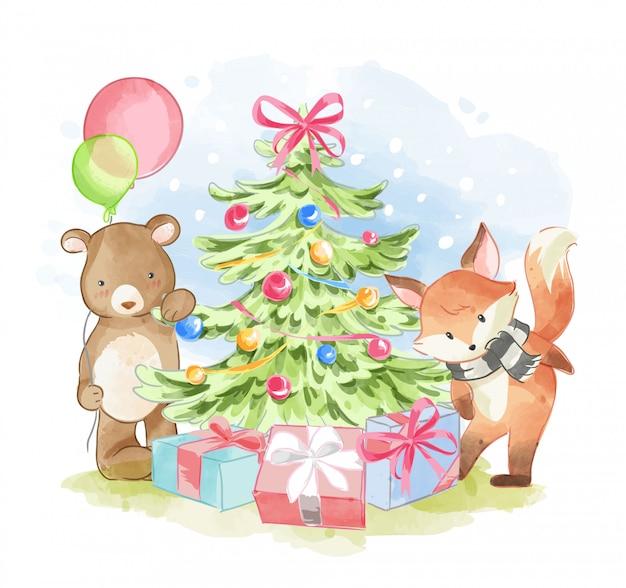 Amici animali con l'illustrazione dell'albero di natale Vettore Premium