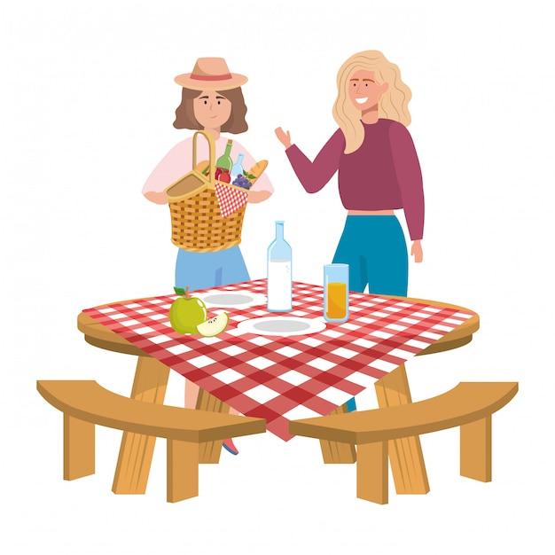 Amici di donne che hanno picnic Vettore Premium