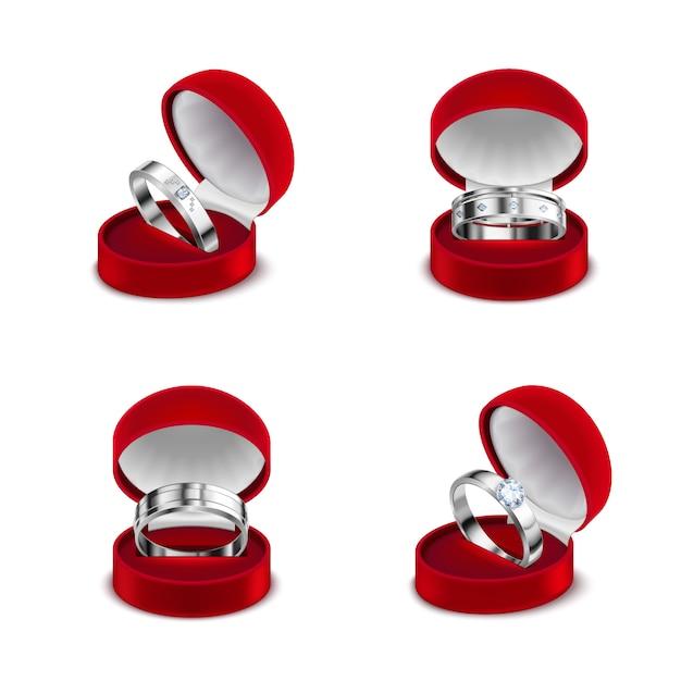 Anelli di diamante di lusso di fidanzamento di nozze dell'argento sterlina dei gioielli 4 nell'illustrazione realistica dell'insieme delle scatole rosse aperte Vettore gratuito