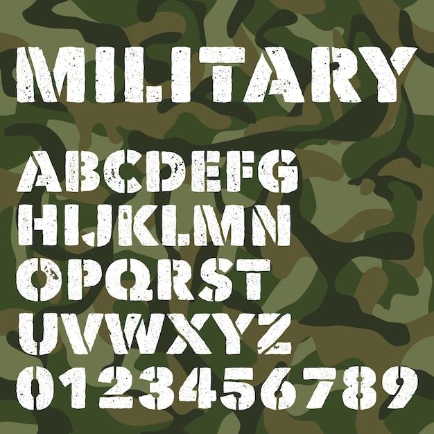 Antico alfabeto militare, lettere in grassetto e numeri su mimetico verde militare Vettore Premium