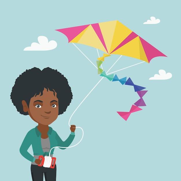 Aquilone di volo giovane donna afro-americana. Vettore Premium