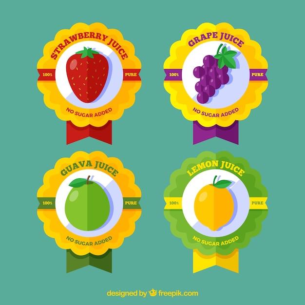 Assortimento di quattro etichette della frutta in design piatto Vettore gratuito