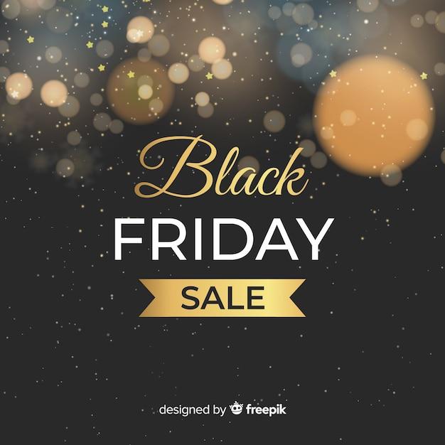 Astratto sfondo nero vendita di venerdì con glitter Vettore gratuito