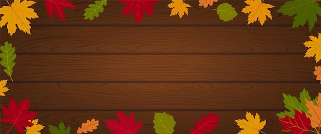 Autumn banner header background sulla plancia di legno strutturato decora con le foglie di acero Vettore Premium