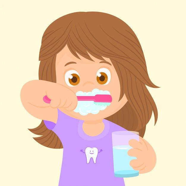 Bambina che si lava i denti Vettore Premium