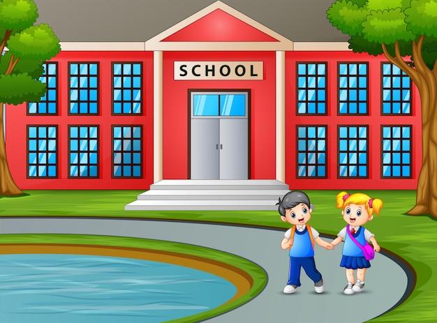 Bambini che camminano e lasciano la scuola dopo le lezioni Vettore Premium