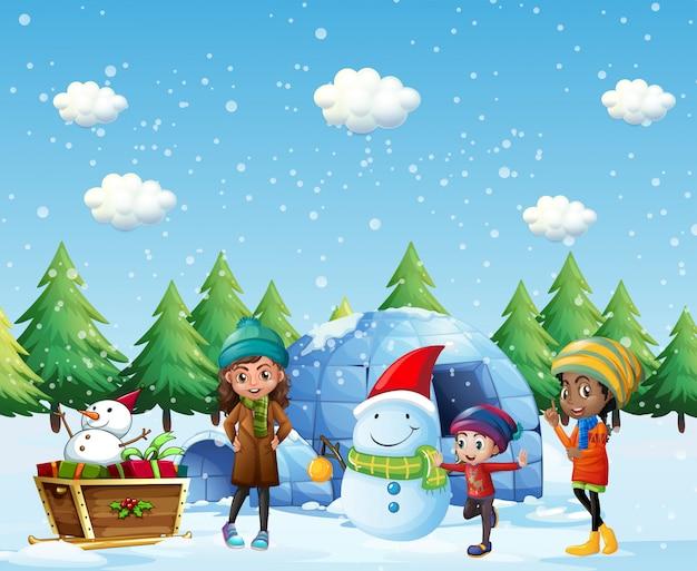 Bambini con igloo e pupazzo di neve in inverno Vettore gratuito