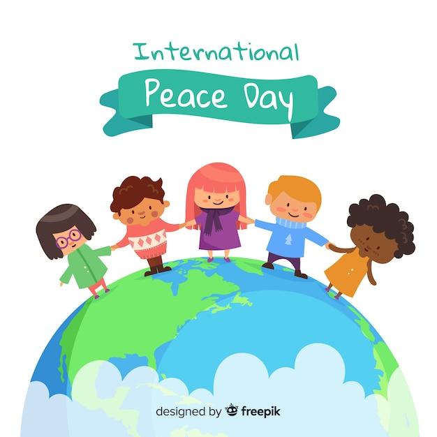 Bambini disegnati a mano di giorno di pace che si tengono per mano sulla terra Vettore gratuito
