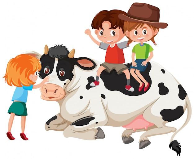 Bambini e mucca su sfondo bianco Vettore Premium