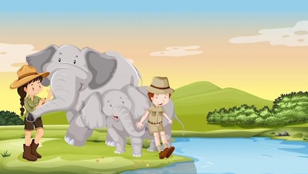 Bambini ed elefanti sul fiume Vettore gratuito