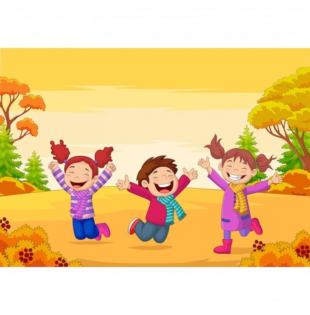 Bambini felici che saltano sull'illustrazione di autunno Vettore Premium