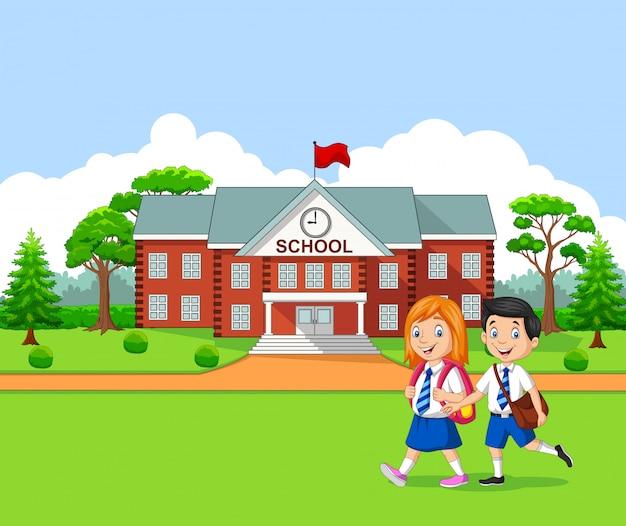 Bambini felici che vanno a scuola Vettore Premium