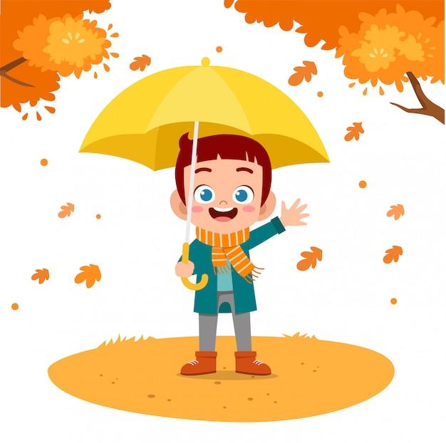 Bambini felici in autunno Vettore Premium