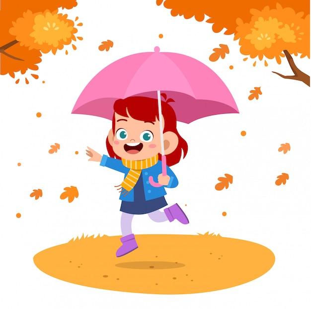 Bambini felici ombrello autunno Vettore Premium