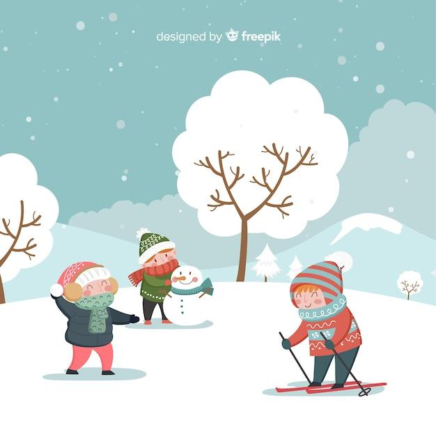 Bambini invernali che giocano sullo sfondo Vettore gratuito
