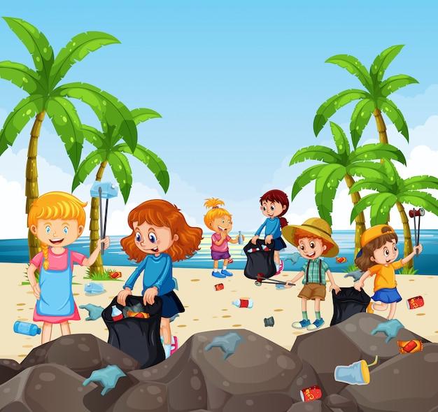Bambini volontari che raccolgono rifiuti in spiaggia Vettore Premium