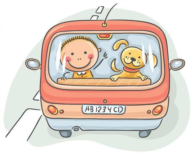 Bambino e cane in macchina Vettore Premium