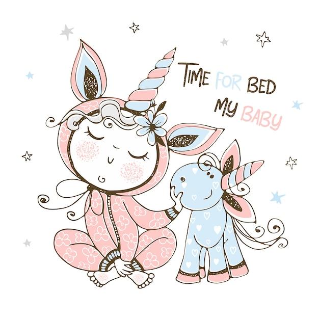 Bambino in pigiama con il suo giocattolo di unicorno. è ora di dormire. Vettore Premium
