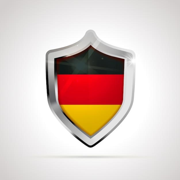 Bandiera della germania proiettata come uno scudo lucido Vettore Premium