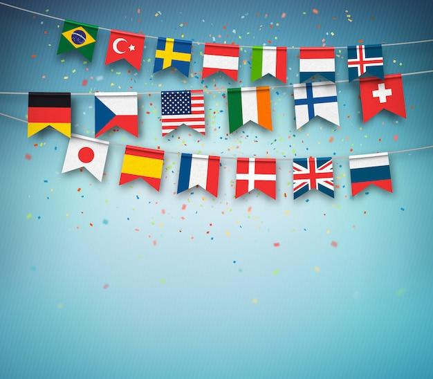 Bandiere colorate di diversi paesi del mondo con coriandoli su sfondo blu Vettore Premium