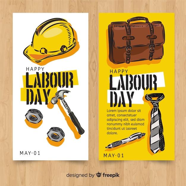Bandiere di festa del lavoro disegnati a mano Vettore gratuito