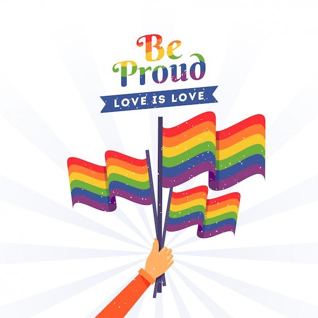 Bandiere di libertà della holding della mano umana in occasione di happy pride Vettore Premium