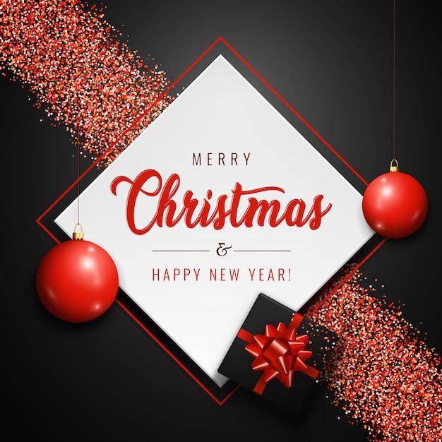 Banner di buon natale con palline rosse, regalo realistico e glitter scintillii su sfondo scuro. Vettore Premium