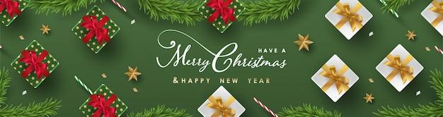 Banner di buon natale e felice anno nuovo con realistici oggetti festivi Vettore Premium