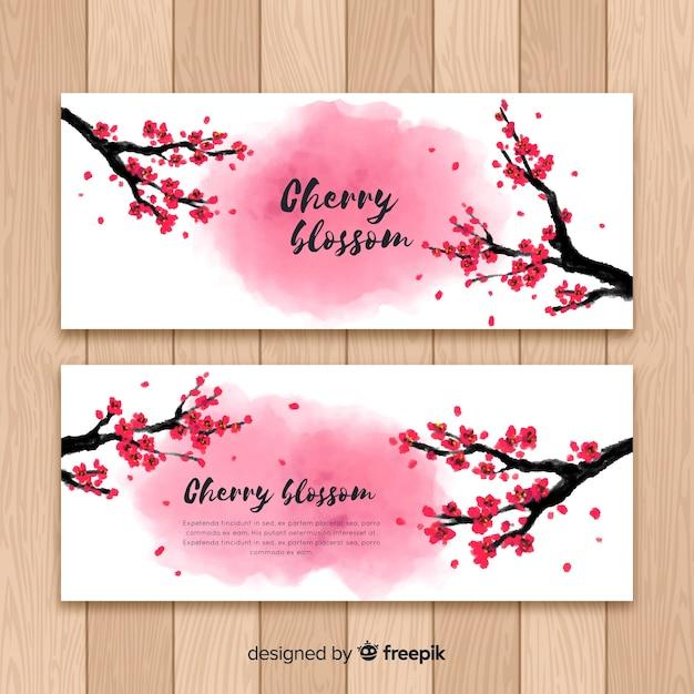 Banner di fiori di ciliegio disegnati a mano Vettore gratuito