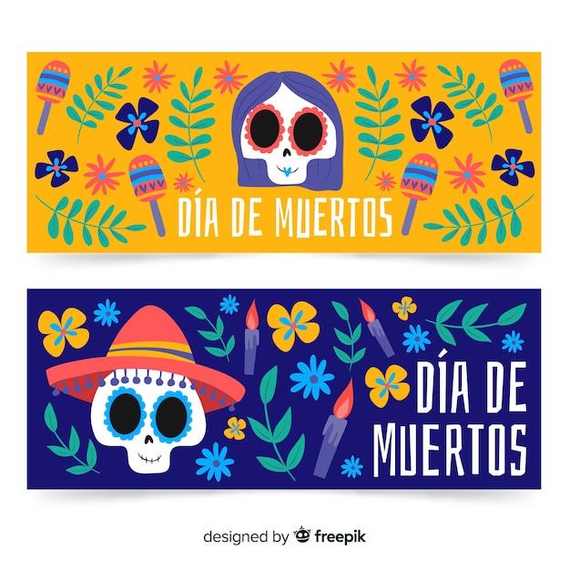 Banner disegnati a mano per il giorno dei morti con teschi Vettore gratuito